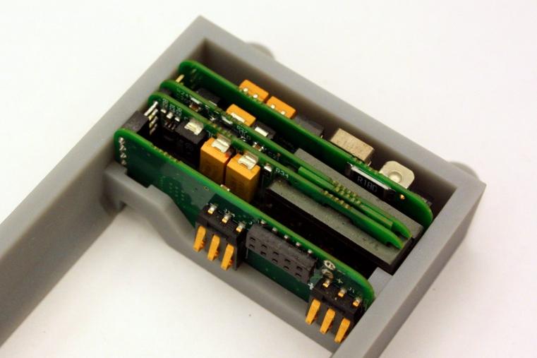 Intelligent solar battery charger inside battery holder